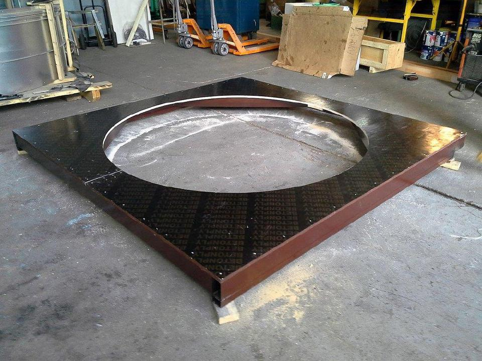 Circle cut out of the construction material that covers the metal frame for the top of the observatory.