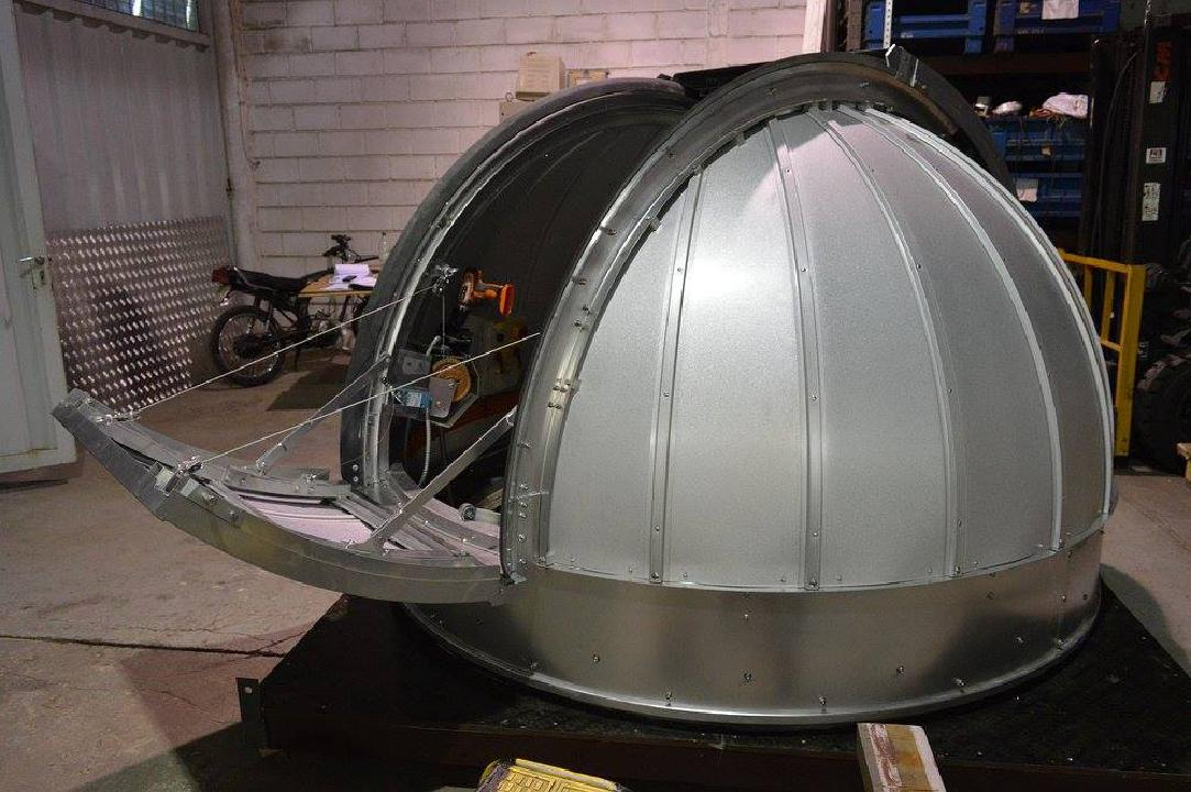 The dome is attached to the base for the top of the observatory.