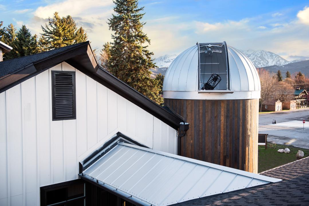 Outdoor view of the HALO Observatory looking at the telescope inside with the Ash-Dome door open