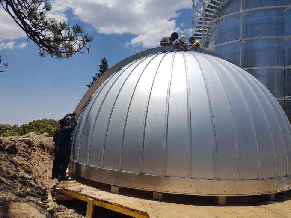 Workers working on the Ash-Dome for TAOS-II before it is installed.
