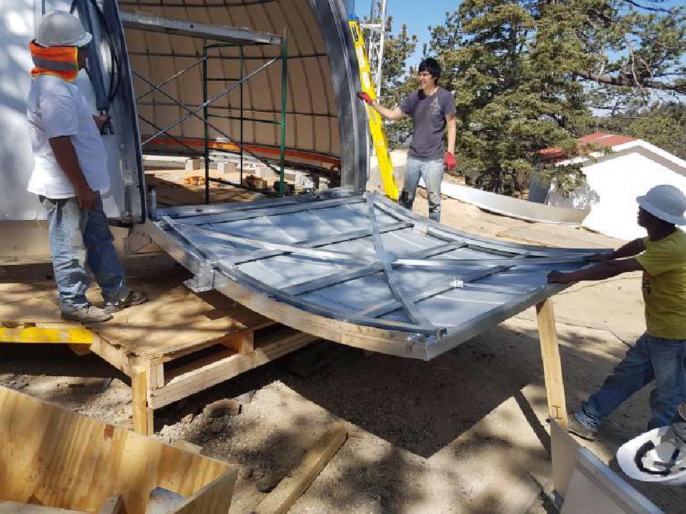 Workers installing the TAOS-II Ash-Dome door.