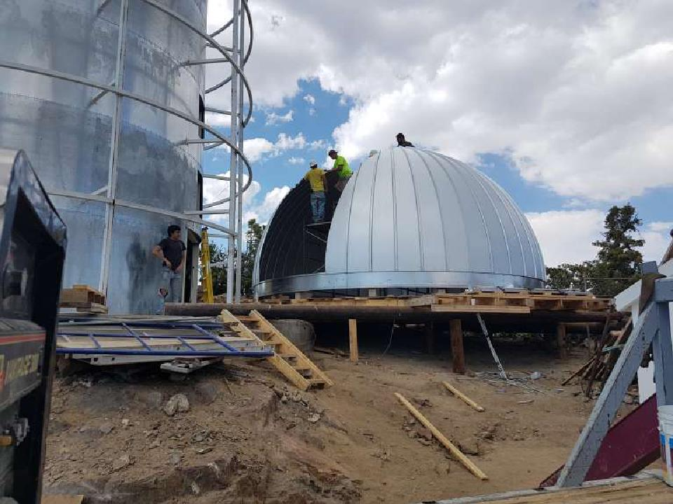 Workers working on the the TAOS-II Ash-Dome before it is installed.