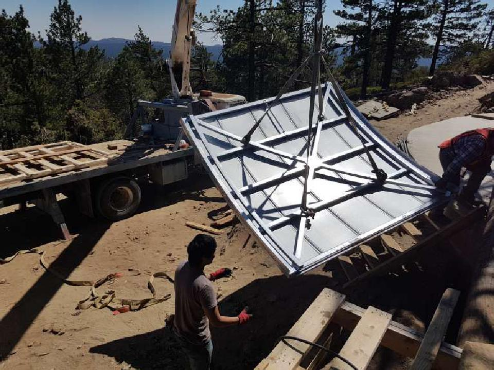 A crane lifting the TAOS-II Ash-Dome door into place.
