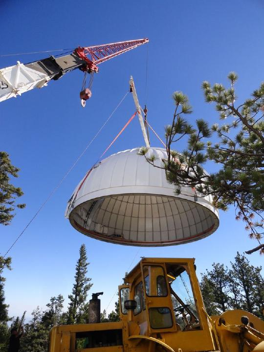 A crane lifting the Ash-Dome for TAOS-II