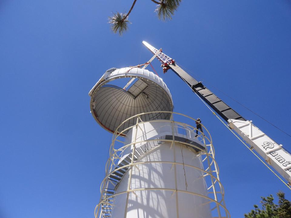 A crane lowering the Ash-Dome on top of TAOS-II
