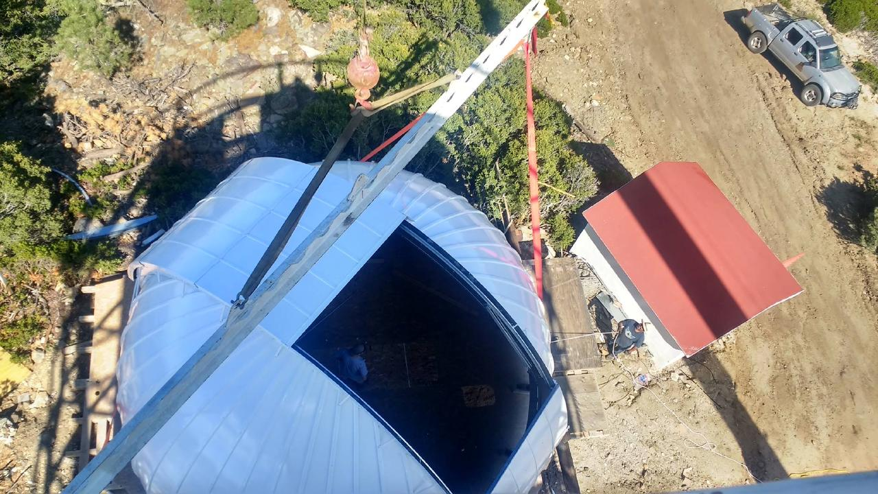 Overhead view of the crane lowering the Ash-Dome on top of TAOS-II