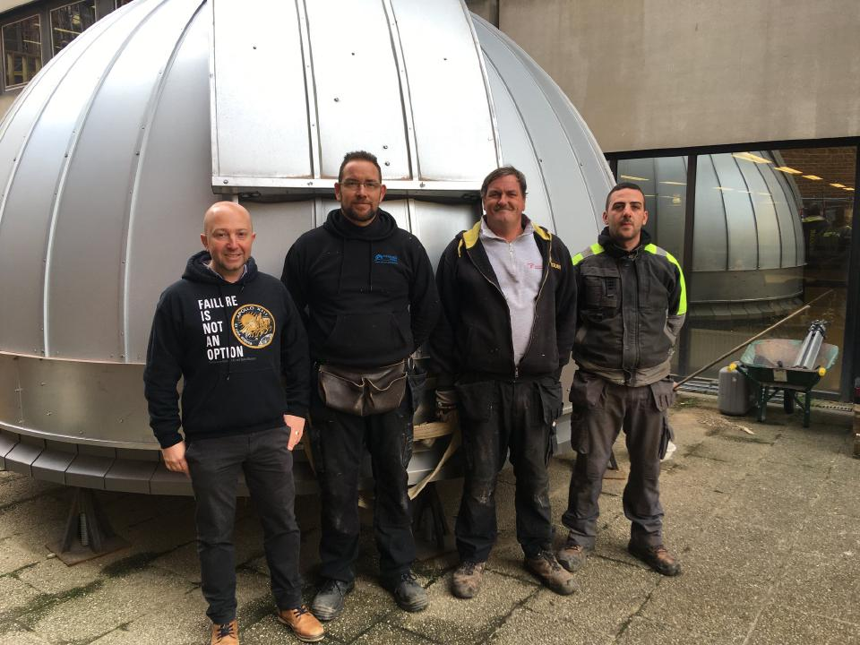 Men posing infront of the Ash-Dome before it is installed at the Namur Observatory